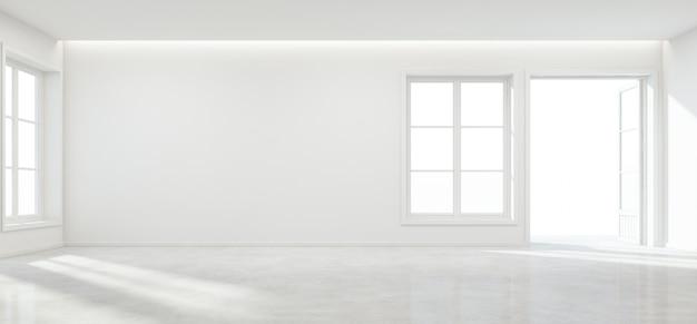 Zaal met betonnen vloer en lege muur in modern huis.