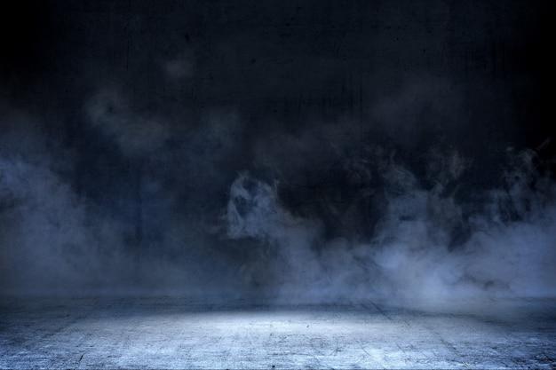 Zaal met concrete vloer en rookachtergrond