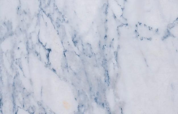Zacht blauw marmer met wazig patroon, textuurachtergrond