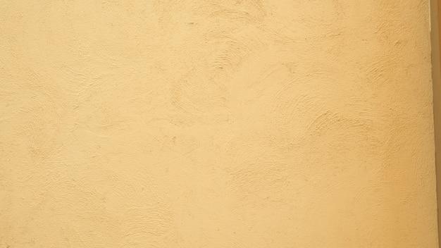 Zachte beige grunge achtergrond oude verweerde grunge muur geschilderd