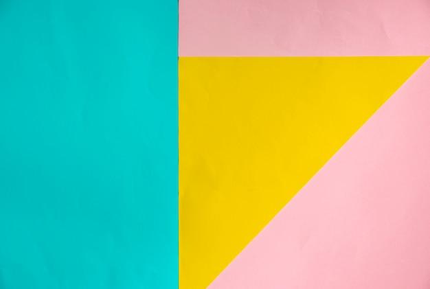 Zachte blauwe, gele en roze pastelkleur papier geometrische plat lag achtergrond