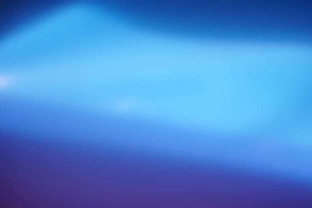 Zachte blauwe kleurovergang bokeh abstracte achtergrond.