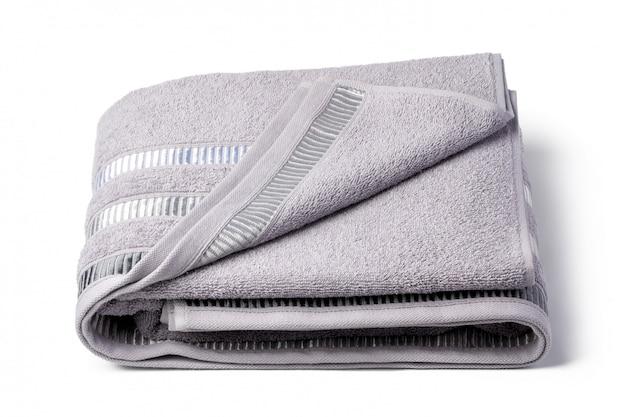 Zachte gevouwen handdoek geïsoleerd op een witte ondergrond