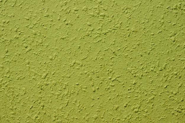 Zachtgroene betonnen muur voor interieurs, kunstbehang of artistieke textuurachtergrond