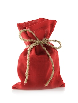 Zak met rode kleur vol geschenken voor het nieuwe jaar, geïsoleerd op een witte achtergrond