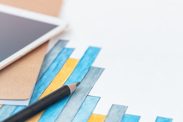 Zakelijke achtergrond met potlood tablet diagram en notebook