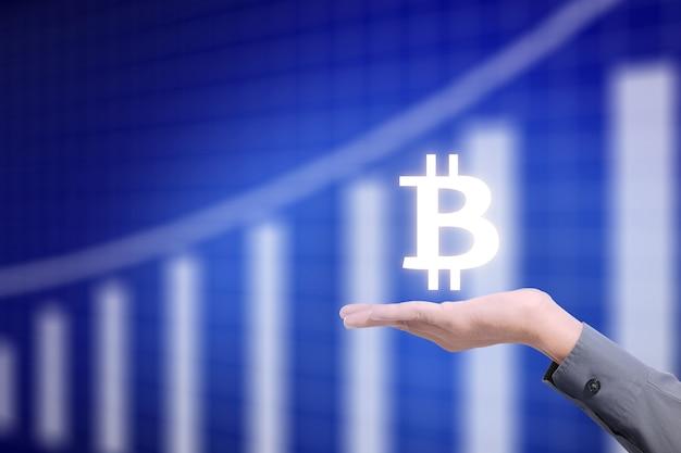 Zakelijke hand met virtuele systeem bitcoin. blockchain technologie concept