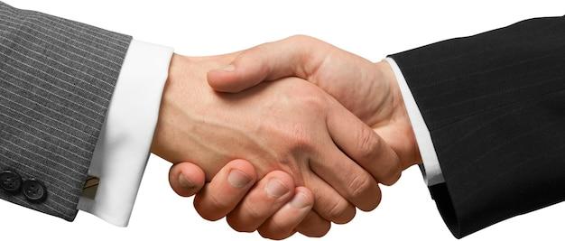 Zakelijke overeenkomst handdruk op achtergrond