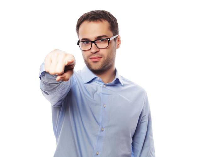 Zaken, succes en mensenconcept - bedrijfsmens die vinger tonen om nummer één te zijn