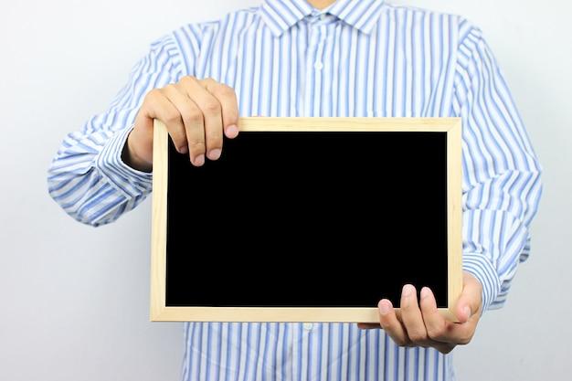 Zakenlieden houden een leeg fotolijstje.