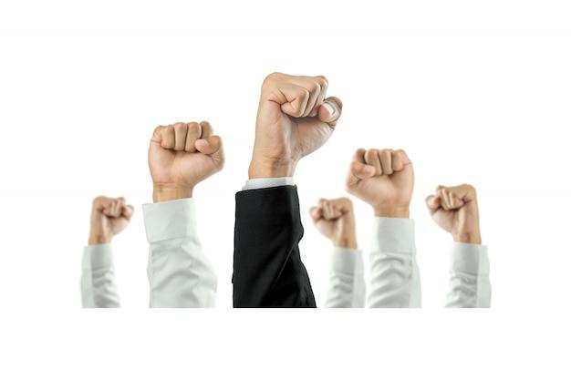 Zakenlieden staken hun hand op om de viering van de organisatie te winnen