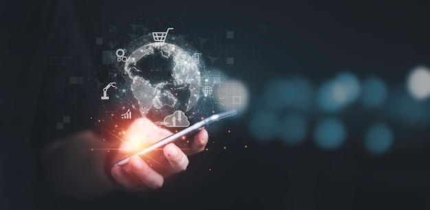 Zakenman die mobiele telefoon gebruikt voor communicatie, werken en transacties, wereldwijde zaken door internetverbindingstechnologie voor financieel bankieren, big data en digitaal koppelingsconcept.