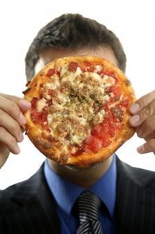Zakenman en ongezonde snel voedsel, pizza