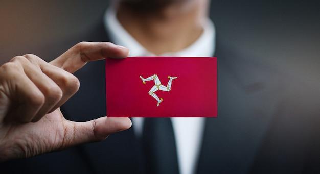 Zakenman holding card van de vlag van het eiland man