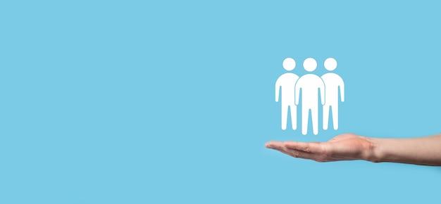 Zakenman houden teamwerk pictogram. een sterk team bouwen. mensen icoon. human resources en management concept. sociale netwerken, assessment center-concept, persoonlijke audit of crm-concept.