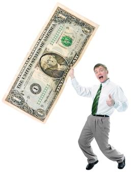 Zakenman houdt groot formaat amerikaanse dollar op witte achtergrond