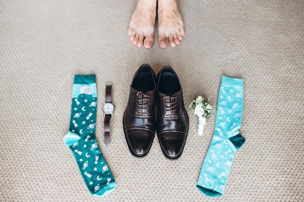 Zakenman kleding details op de vloer