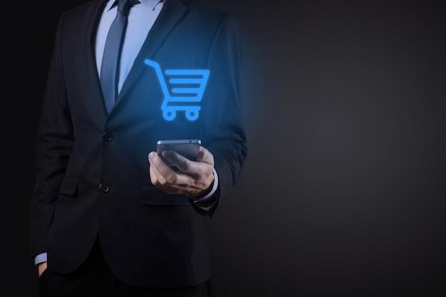 Zakenman man met winkelwagentje trolley mini kar in zakelijke digitale betalingsinterface