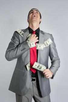 Zakenman met dollar notities pak en stropdas