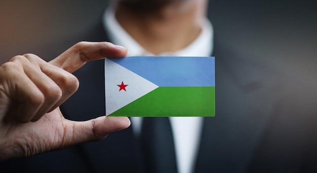 Zakenman met kaart van djibouti vlag