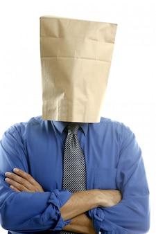 Zakenman met papieren zak in hoofd