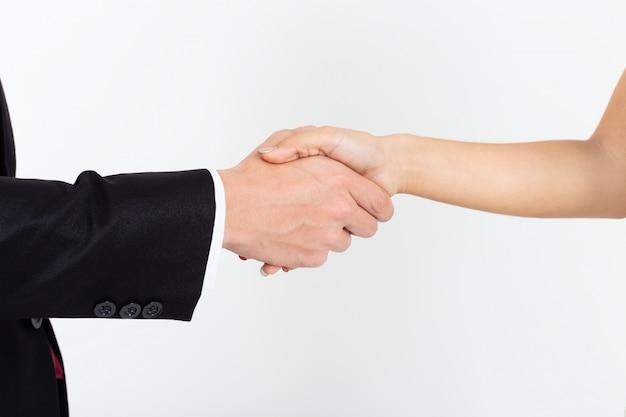 Zakenmanhanddruk met jonge secretaressevrouw op wit