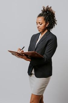 Zakenvrouw schrijven op haar planner