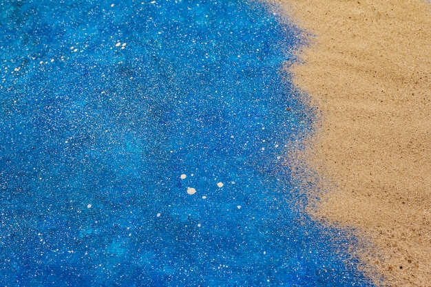 Zand en blauw glitter
