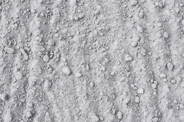 Zand met stenen achtergrond
