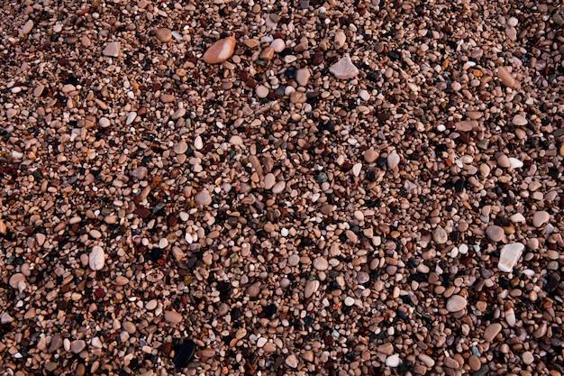 Zeeachtergrond van zand en klein grind voor uw ontwerp