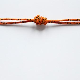 Zeevaart oranje kabelknoop met schaduwen