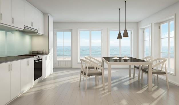 Zeezicht eetkamer en keuken in strandhuis.