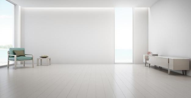 Zeezicht grote woonkamer van luxe zomer strandhuis met tv-standaard en houten kast.