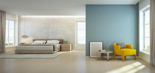 Zeezicht slaapkamer en woonkamer in luxe strandhuis.