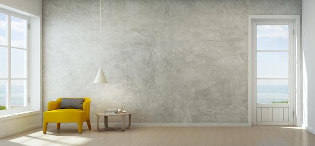 Zeezicht woonkamer met betonnen muur in modern strandhuis.