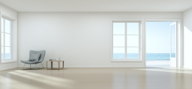Zeezicht woonkamer met lege muur in modern strandhuis.
