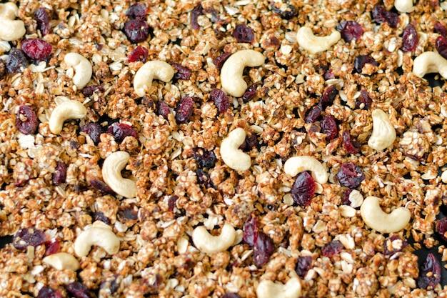 Zelfgemaakte muesli met cashewnoten en veenbessen. vullende achtergrond