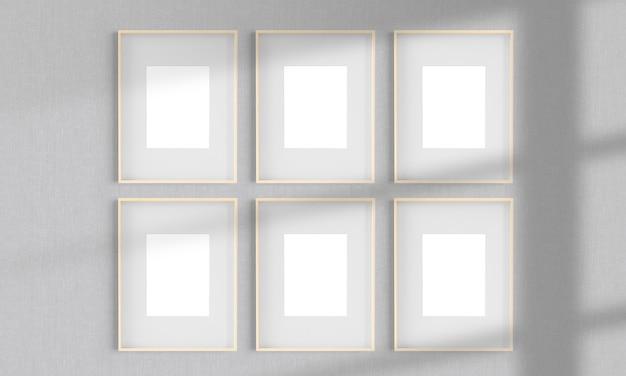 Zes houten frames op een muurmodel 3d-rendering