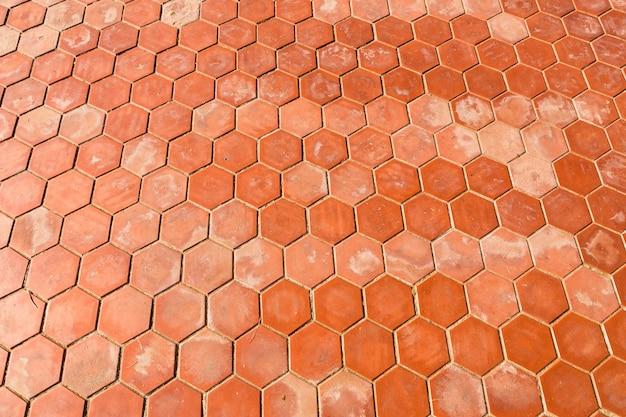 Zeshoekige klei tegels textuur achtergrond