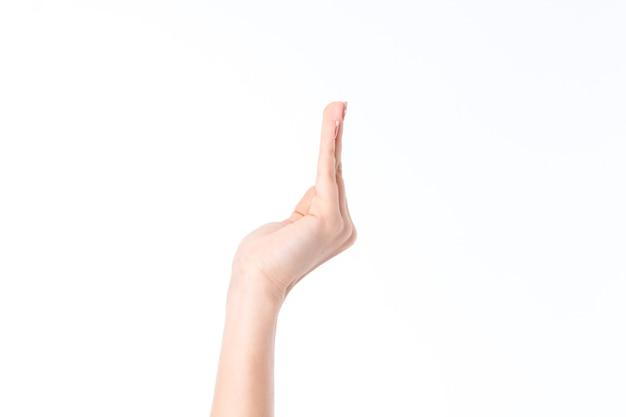 Zijaanzicht van de hand van de vrouw met opgeheven vingers geïsoleerd op een witte achtergrond