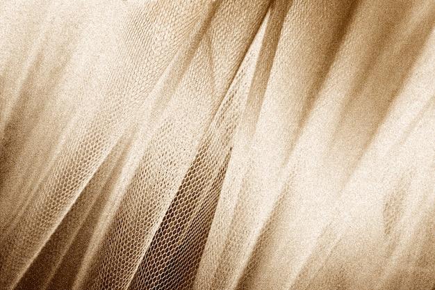 Zijdeachtige gouden stof met slangenleer