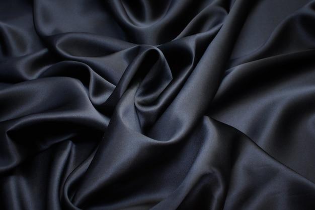 Zijden stof, satijn. zwarte kleur. textuur,