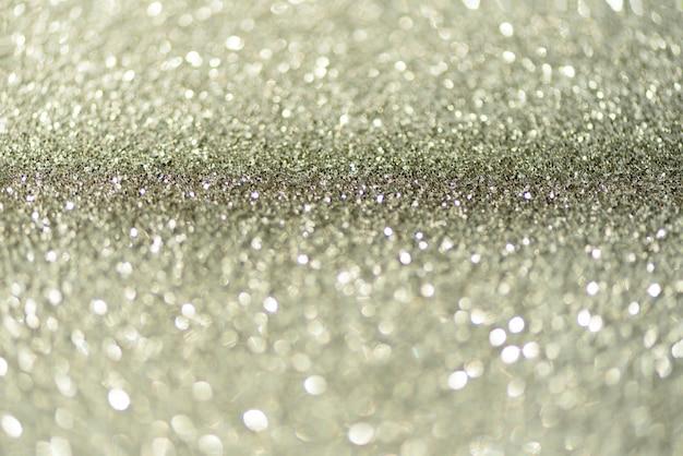 Zilver glitter achtergrond met abstracte bokeh lichten.