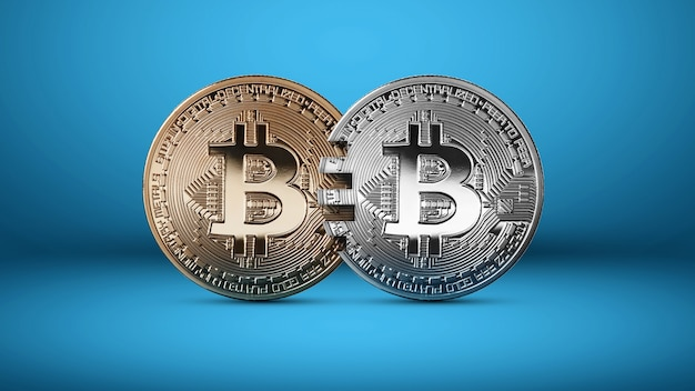 Zilveren en gouden bitcoin-munten op een blauwe achtergrond. het concept van blockchain-technologie en geldoverdrachten. mastercard analoog concept. conceptueel beeld voor cryptovalutamarkt. kan worden gebruikt voor video
