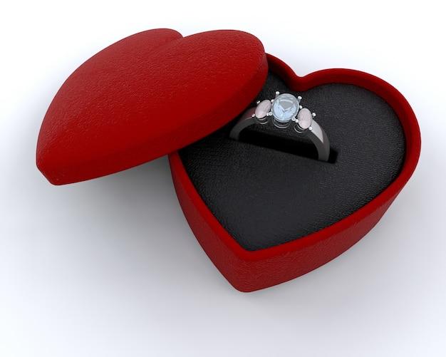 Zilveren engagment ring in een hartvormige doos