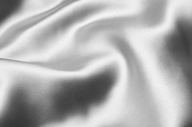 Zilveren golvende zijdetextuur als achtergrond