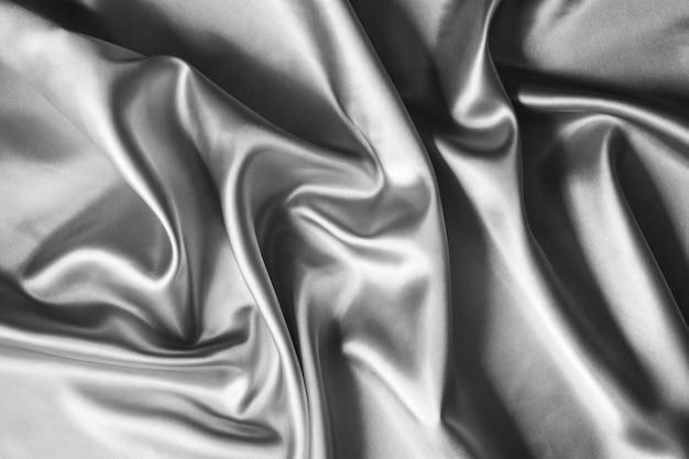 Zilveren golvende zijdetextuur