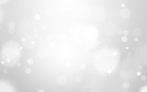 Zilveren lichte en witte kerstmisachtergrond met onduidelijk beeld bokeh mooie textuur. glow schittering
