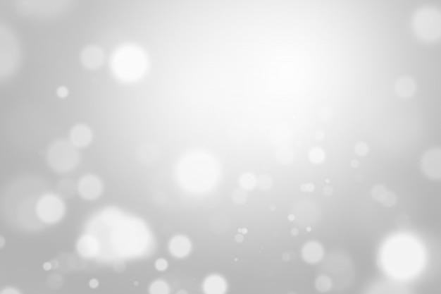 Zilveren lichte kerstmisachtergrond met bokeh