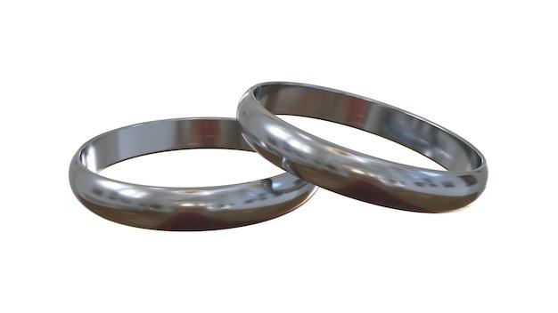 Zilveren verlovingsringen op witte achtergrond. de een boven de ander.
